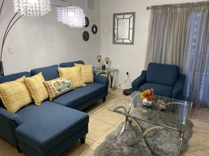 Signature Design by Ashley - Jarreau Mid-Century Upholstered Sofa Chaise Sleeper, Blue for Sale in Miami, FL