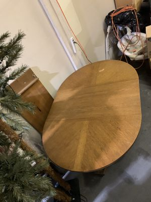 Wooden Dining room table with leafs and 6 chairs for Sale in Upland, CA