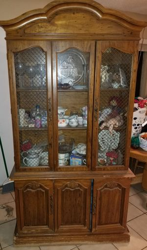 Antique China Cabinet With Meshed Wire, And Built In Light Fixture . Items inside the cabinet Are not part of the sale. for Sale in Lake Elsinore, CA