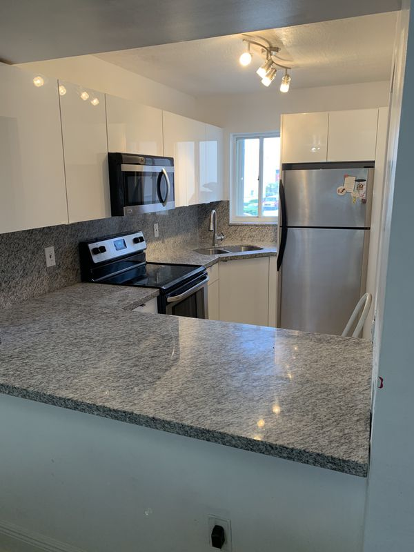 Kitchen Cabinets - countertop included - all custom made to your preference with many materials and colors