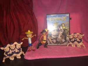 Shrek Lot sale ! Zorro the cat, Pinocchio, three little pigs happy meal toy figurines and Shrek 2 DVD lot sale! for Sale in Phoenix, AZ