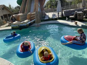 Real working bumper boats with a large inflatable pool for Sale in Riverside, CA