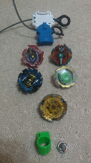 5 beyblades and two launchers for Sale in Annandale, VA