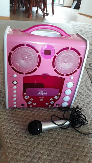 Pink karaoke machine + microphone and 2 CDs for Sale in Hayward, CA