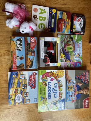 New toys puzzle games originally packed. $ 5 each. Dog purse $ 7 for Sale in Bedford Park, IL