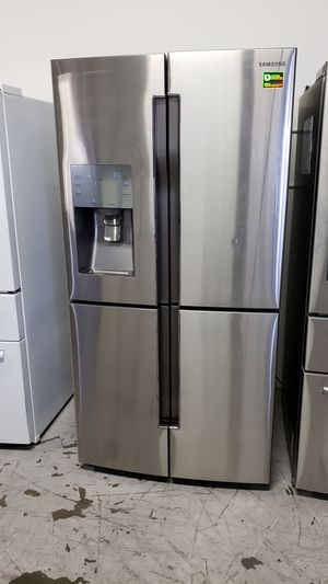 STAINLESS STEEL 28 CUBIC FRENCH 4 DOOR FRIDGE SAMSUNG REFRIGERATOR FREE DELIVERY AND WARRANTY for Sale in Garden Grove, CA
