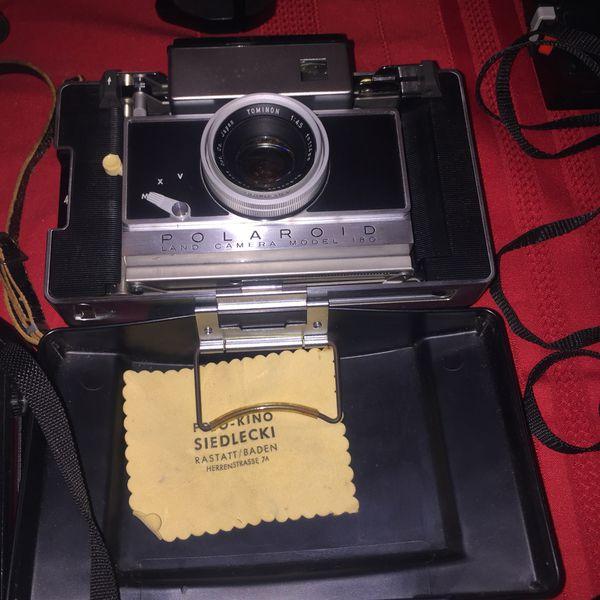 Lot of 24 vintage cameras & lenses