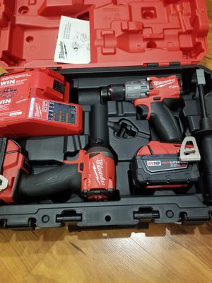 Milwaukee full hammer drill and impact 2 battery 5.0 and charger for Sale in Chicago, IL