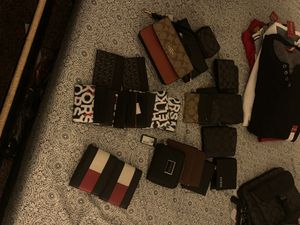 All brand new coach, michael kors , guess , tommy hilfiger wallets dm for prices for Sale in Valley Center, CA