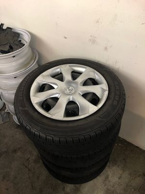 Mazda 3 stock wheels and tires with hubcaps for Sale in Bonney Lake, WA