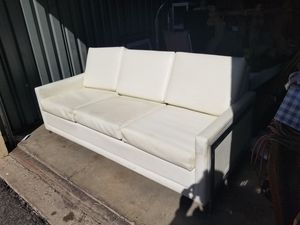 White leather sleeper sofa / couch with chrome side supports for Sale in Tucson, AZ