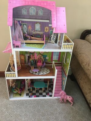 Barbie Doll House-almost new; comes with lot of accessories and Barbie dolls for Sale in Sudbury, MA