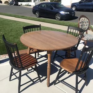 Wood table And Four Chairs Great Condition Has A Leaf To Expand The Table for Sale in Tustin, CA