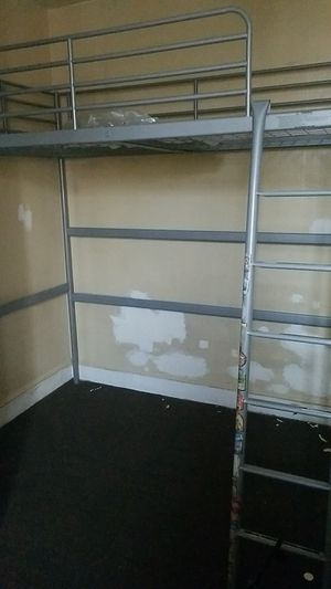 Twin bunk bed with ladder and desk or other bed underneath for Sale in Philadelphia, PA