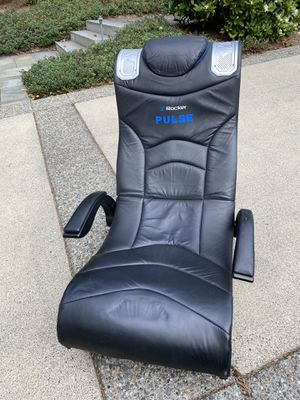 Gaming chair - foldable - black- leather -headphone jack with volume and bass for Sale in Bellevue, WA