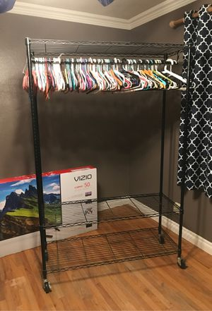 """Heavy duty rolling clothing rack. Has 2 bottom shelves and a top shelf. Measures 17.5"""" deep, 47"""" wide across the front and 74"""" tall. Perfect condition for Sale in Anaheim, CA"""