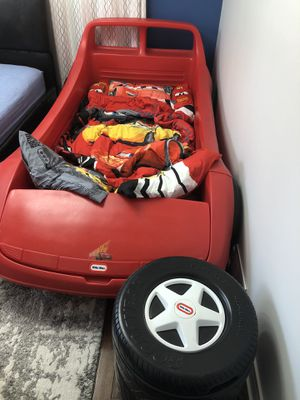 Red car bed with storage trunk and tire storage bin for Sale in Schaumburg, IL