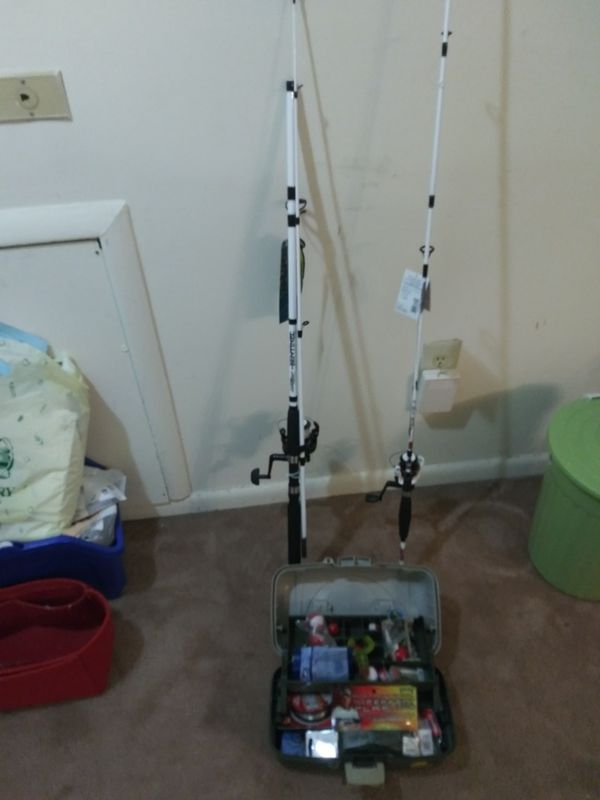 Fishing rod and tackle box full of hooks,weights and lures