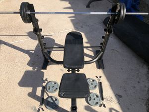 Adjustable workout bench press , With straight Bar & adjustable dumbbells with weight plates..$315 OBO for Sale in Glendale, AZ