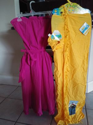 2 sweet dresses. Shoulderless. Pink with the and bottom ruffle. And. New yellow surong for Sale in Henderson, NV