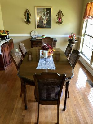 Kitchen table with an leaf in middle and seven chairs for Sale in Mt. Juliet, TN