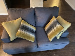 gray/silver love seat couch & yellow accent pillows for Sale in Cary, NC