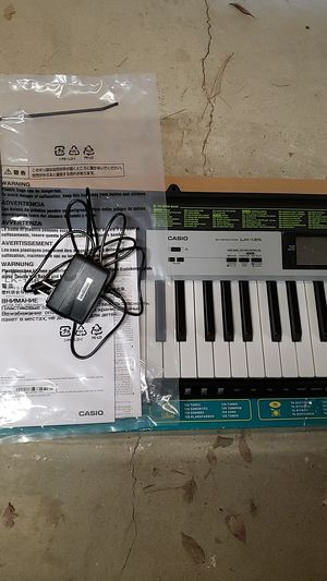 Casio Key Lighting Keyboard Piano 61 Keys LK-135 with Stand for Sale in Fresno, CA