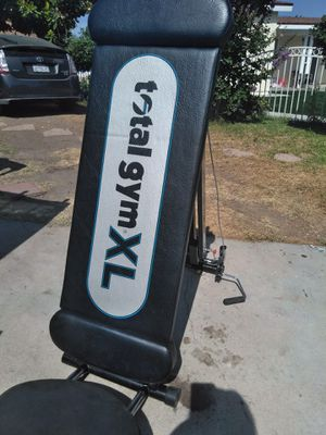 Total Gym XL exercise machine 100/ movements in one machine for Sale in Colton, CA