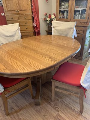 Amish oak table and 4 chairs with Hutch for Sale in Rochester, MN