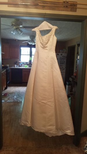 Wedding dress. We think J. Andrews collection for Sale in Hiram, GA