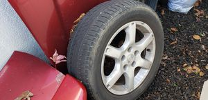 Original Nissan Rims with Tires for Sale in Modesto, CA