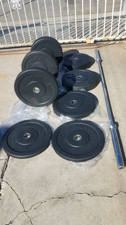 700lbs capacity 7 foot Olympic 45lbs barbell with 230lbs Bumper plates Brand New for Sale in Los Angeles,  CA