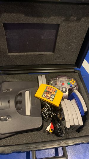Nintendo 64 with case and 9 games including Donkey Kong (DK), banjo kazooie, Mario kart and more for Sale in Kennewick, WA