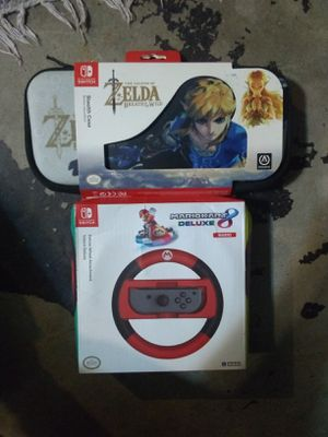 nintendo switch accessories zelda case and mario kart wheel for Sale in University City, MO